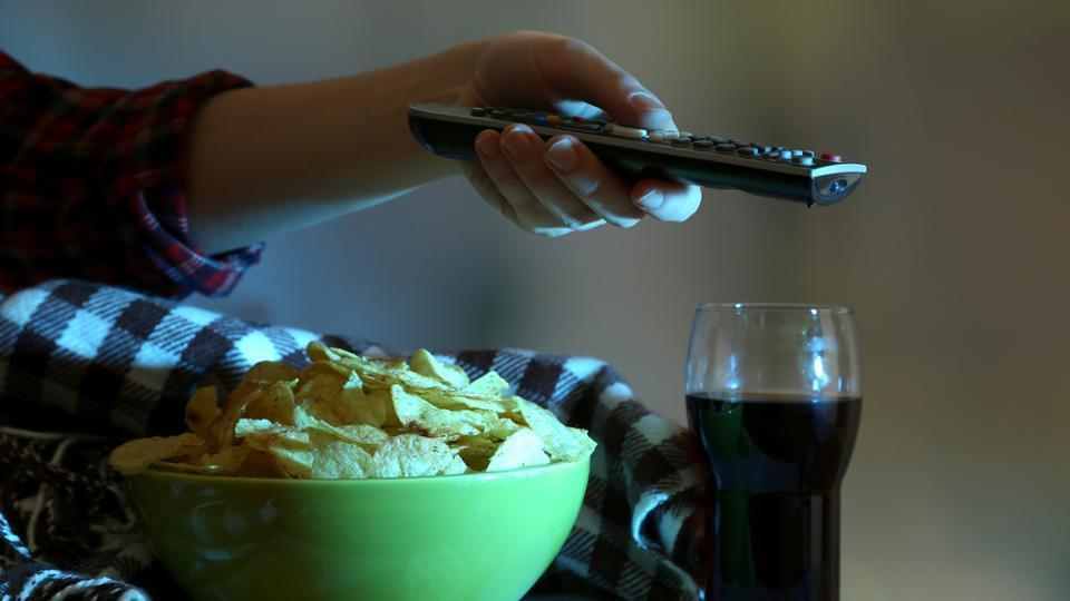 People tend to snack and sit still for prolonged periods while watching TV.