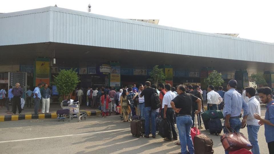 A long queue of passengers at the entrance of Jay Prakash Narayan International Airport, Patna