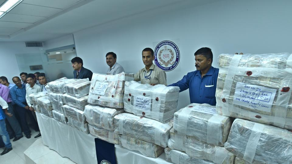 NIA seized demonetized currency of more than Rs 36 crore and arrested nine people in this connection with terror funding case in Jammu and Kashmir.