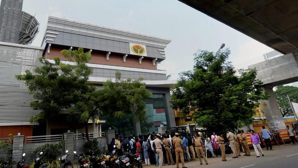 """Media personnel stand guard in front of the """"Jaya TV"""" where IT officials conducted a raid, in Chennai on Nov 9."""