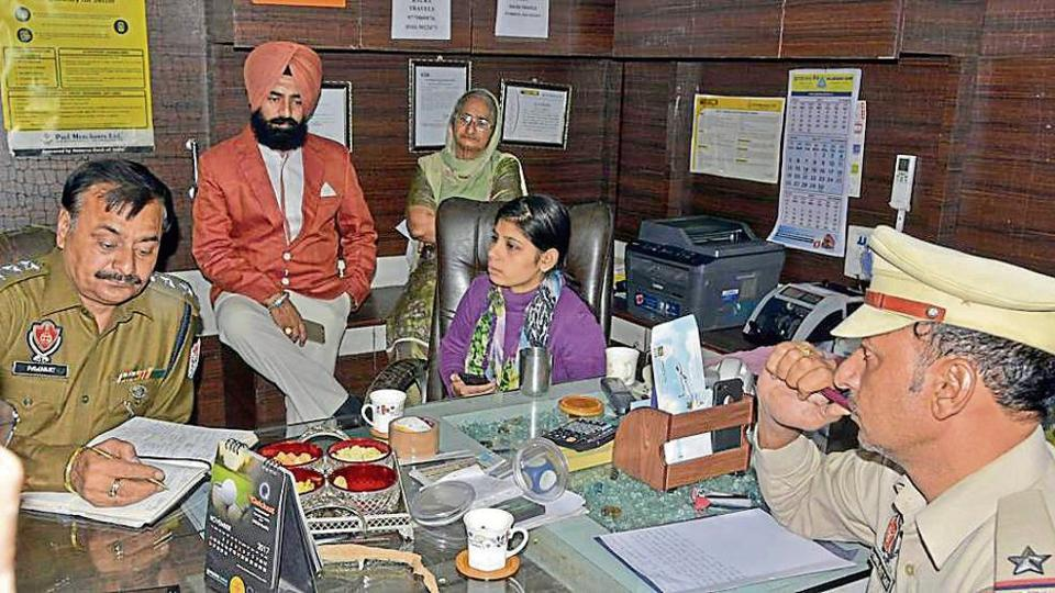 Victim Sarini Sharma narrating the incident to police officials at her employer's office on Noorwala Road in Ludhiana on Sunday.