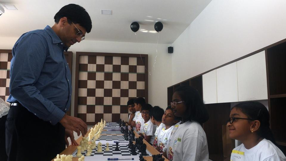 World Champion Viswanathan Anand, plays a game of chess with children during an event in Pune on Saturday.