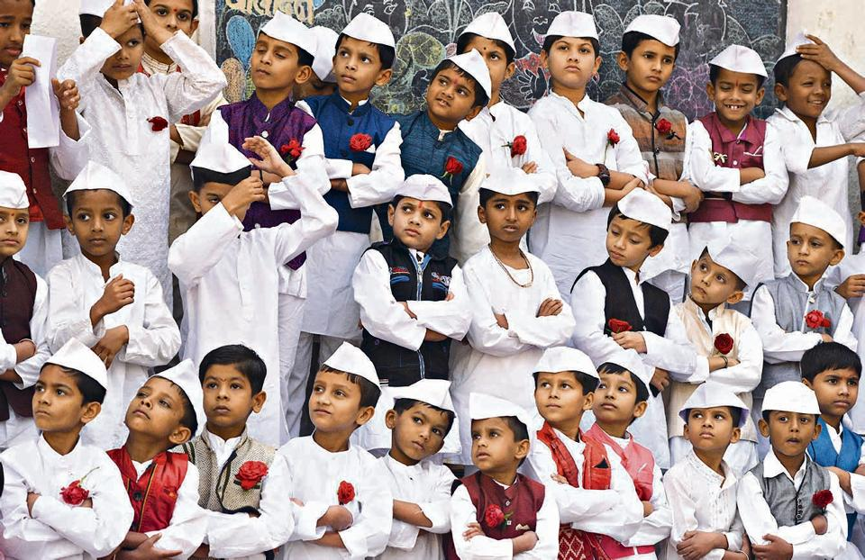 Students of Nutan Marathi Vidyalaya dressed up as Pandit Jawaharlal Nehru pose during the Children's Day celebrations held at the school in Pune on Monday.