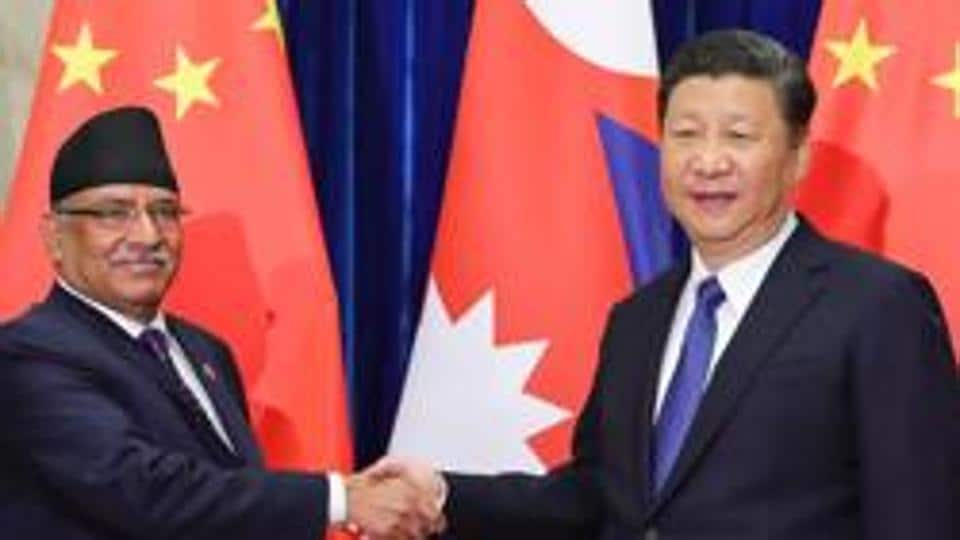 Chinese President Xi Jinping (right) shakes hands with former Nepal prime minister Pushpa Kamal Dahal at the Great Hall of the People in Beijing on March 27, 2017.