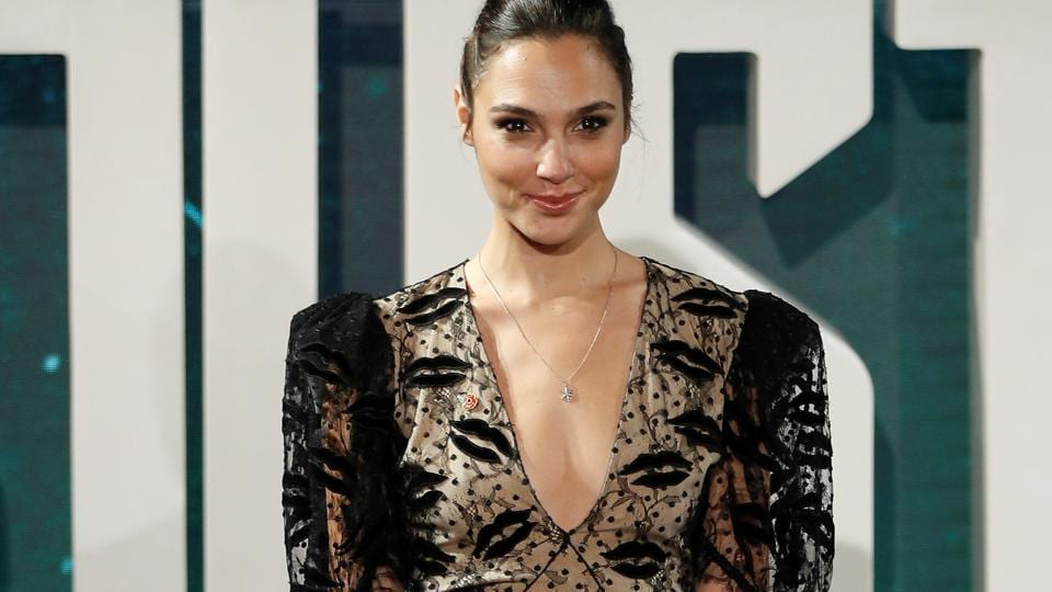 Actor Gal Gadot poses for photographers at the Justice League photocall, at The College, in London.