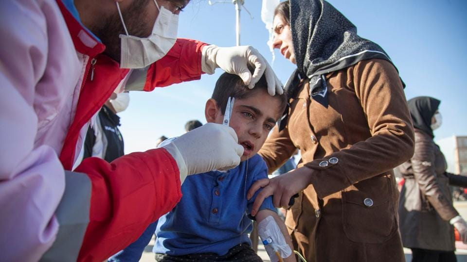 A wounded boy is treated by members of the Red Crescent  following a quake in Sarpol-e Zahab, which reorded the highest casualties in Kermanshah, Iran. The Students News agency ISNA quoted the coroner's office in the province as saying that the death toll was expected to increase. (Tasnim News Agency / REUTERS)