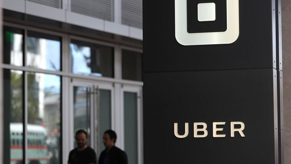 The logo of the ride sharing service Uber seen in front of its headquarters in San Francisco, California on August 26, 2016.