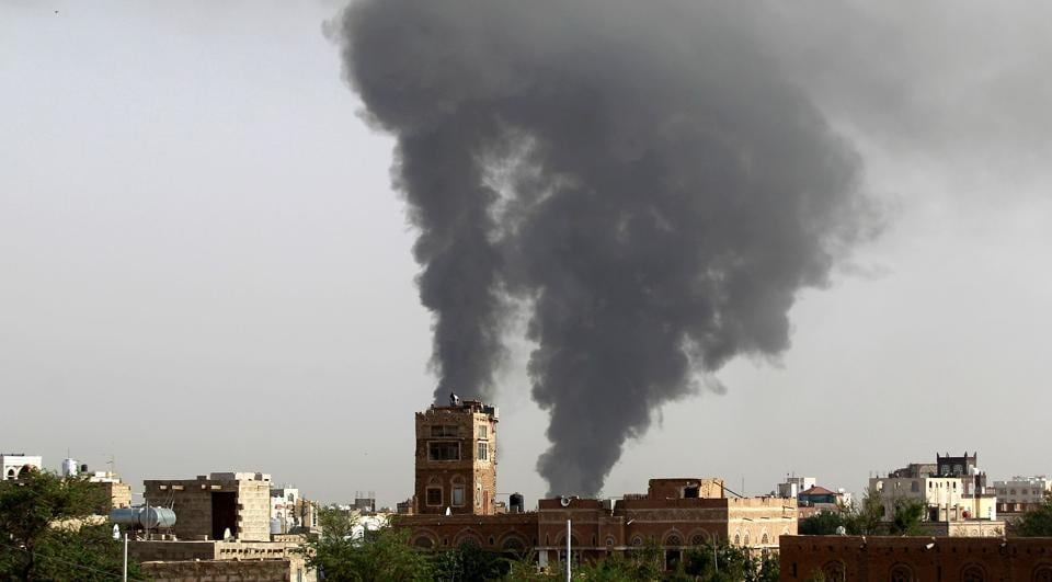 This file photo taken on July 07, 2015 shows smoke billowing following air-strikes by the Saudi-led coalition on a weapons depot at a military airport in the capital Sanaa.  Saudi Arabia's mission to the United Nations says the Saudi-led coalition fighting Shiite rebels in Yemen will begin reopening airports and seaports in the Arab world's poorest country.