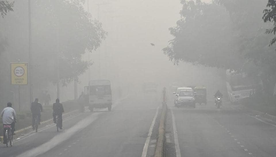 People commute through dense smog in New Delhi on Monday morning. The air pollution in Delhi NCR continues to be above the hazardous level.