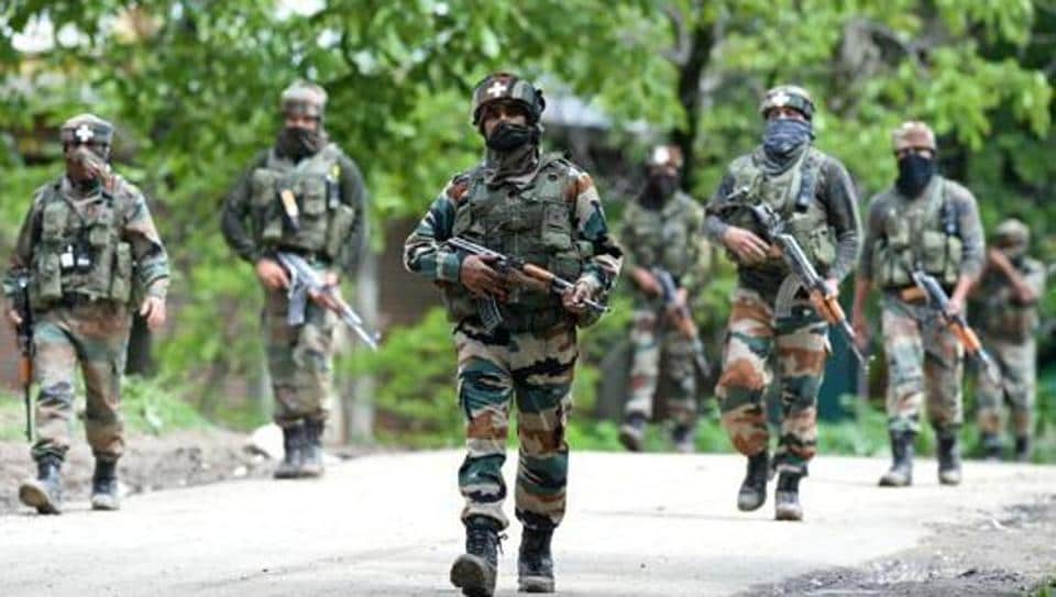 Army personnel conduct a patrol during an operation against militants in Kashmir.