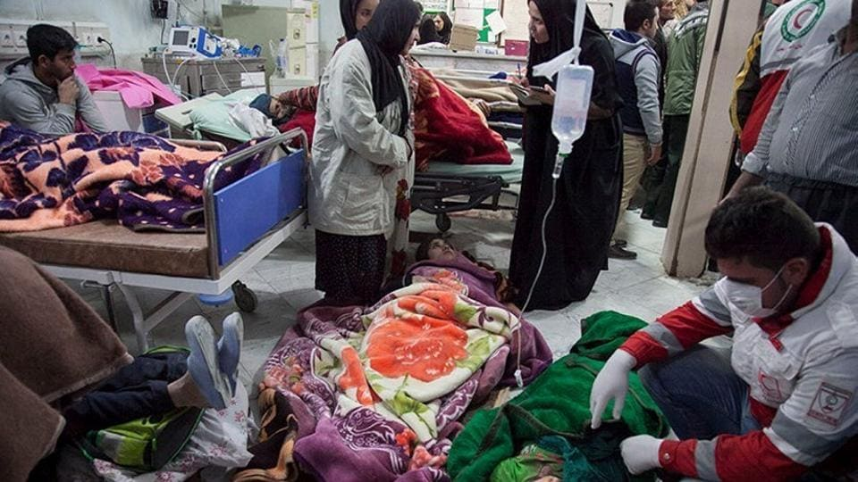 People receive treatment following an earthquake in Sarpol-e Zahab county in Kermanshah, Iran November 13, 2017.  The main hospital of the capital of the county was severely damaged and could not treat hundreds of injured people who were taken there, the head of the Iranian emergency services, Pirhossein Koulivand said. (Tasnim News Agency / Handout via REUTERS )