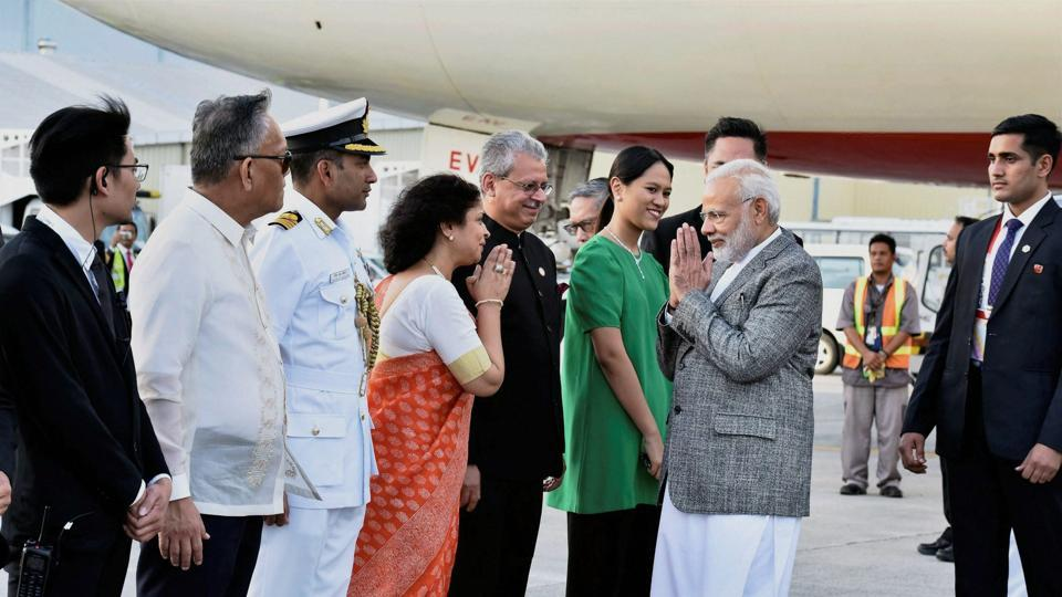Prime Minister Narendra Modi being welcomed on his arrival in Manila to attend the ASEAN-India and East Asia Summits, on Sunday.