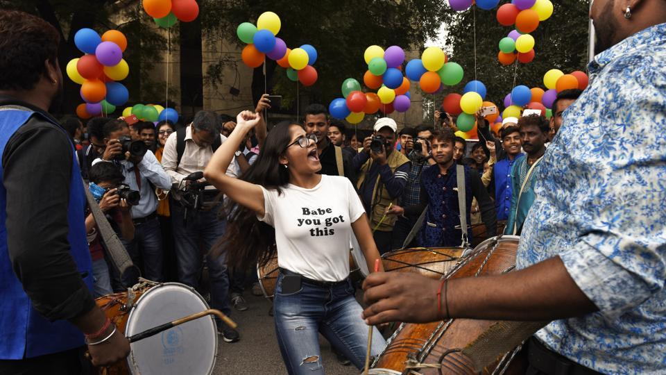 A woman participating in the LGBTQ pride march is seen dancing  in a show of solidarity in New Delhi. (Sanchit Khanna/HT PHOTO)