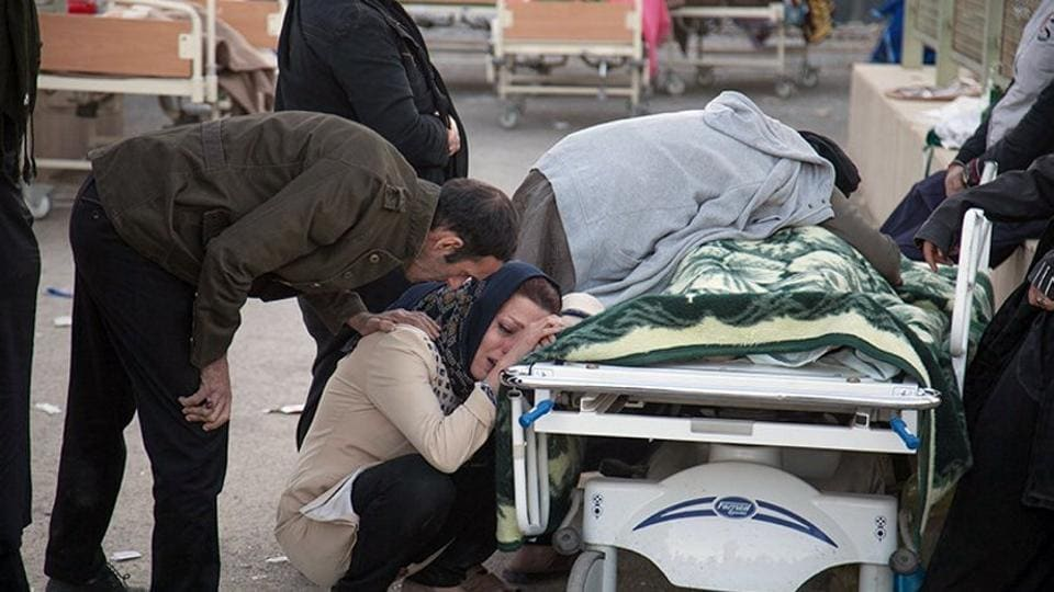 A woman reacts next to a dead body following an earthquake in Sarpol-e Zahab in Kermanshah, Iran. The 7.3-magnitude quake was centered 31 kms outside the eastern Iraqi city of Halabja yesterday, according to measurements from the US Geological Survey. Its impact was felt as far west as the Mediterranean coast with worst damage appearing to be in Iran's western Kermanshah province, which sits in the Zagros Mountains dividing Iran and Iraq. (Tasnim News Agency / Handout via REUTERS )