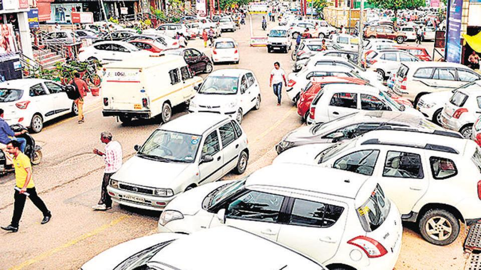 Unauthorised parking in the Sector 18 market has been a major cause of traffic congestion in the area.