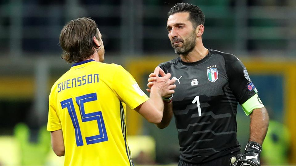 Italy's Gianluigi Buffon shakes the hand of Sweden's Gustav Svensson after their FIFA World Cup play-off against Sweden.