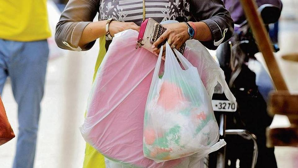 A team of civic officials are visiting markets, speaking to vendors and convincing them not to hand out plastic bags.