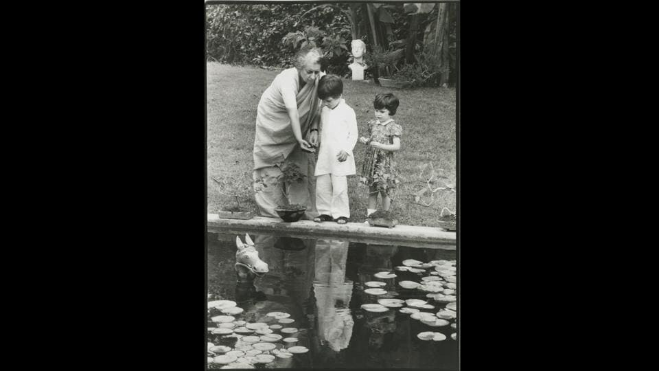 Indira Gandhi with her grandchildren Rahul (L) and Priyanka (R), circa 1975, photographed by Paul Saltzman. She was very fond of the kids and this photograph was taken by the lotus pond, in the garden of her official residence 1, Safdarjung Road, which is now the Indira Gandhi Memorial.  (Courtesy Indira Gandhi Memorial Trust Archive)
