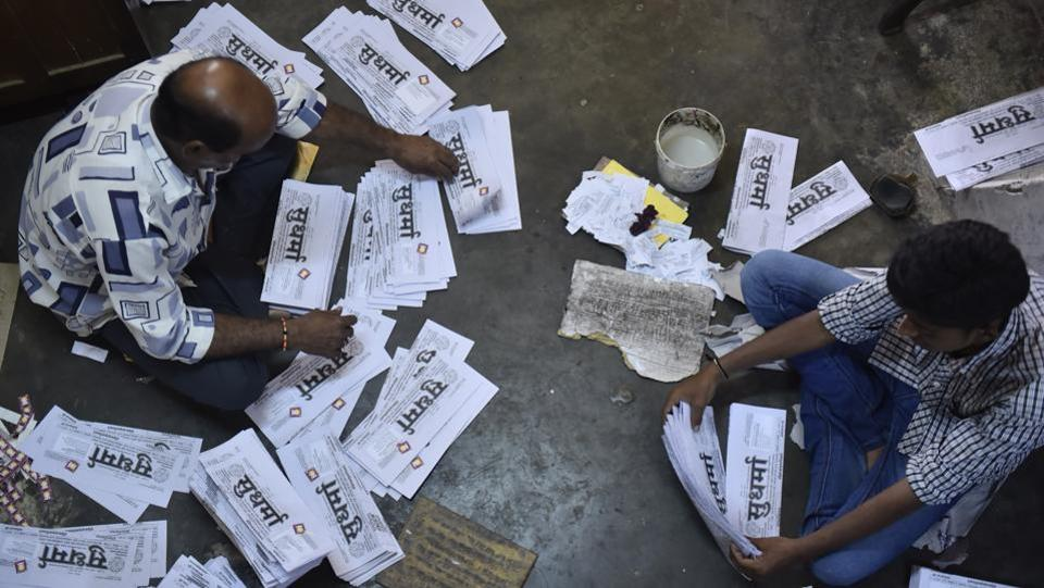 Workers fold the two-page daily at the press in Mysuru. In this age of high-blitz marketing and visibility, Sudharma –with its nearly 4,000 subscribers-- has stuck to its roots. The newspaper has no marketing team, let alone a marketing budget. (Arijit Sen / HT Photo)
