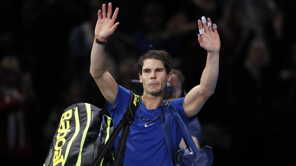 Rafael Nadal waves to supporters after losing his ATP Finals match against David Goffin in London.