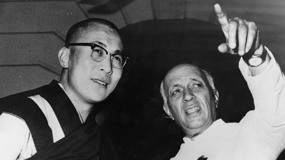 Tibetan spiritual leader Dalai Lama and Nehru in New Delhi during a meeting to discuss the rehabilitation of Tibetans who crossed the border to India during the Chinese/Tibetan crisis.  (Central Press / Getty Images)