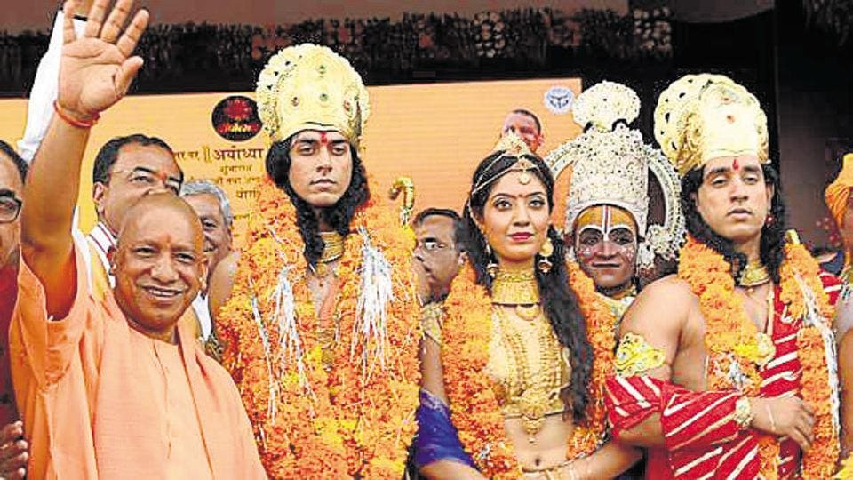 Uttar Pradesh CM Yogi Adityanath with artistes dressed up as Indian deities Ram, Sita and Lakshman at the Deepotsav celebrations in Ayodhya on October 18, 2017.