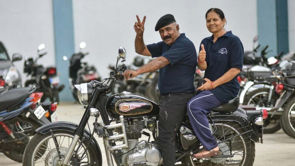 Anand Singh Shekhawat and his wife Krishna Shekhawat who went to Mysore from Kota on a bike to participate in a national-level swimming competition;  Krishna bagged three medals.