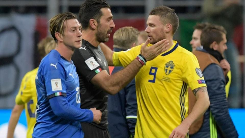 Italy's goalkeeper Gianluigi Buffon (C) officially announced his retirement after the defeat. (AFP)