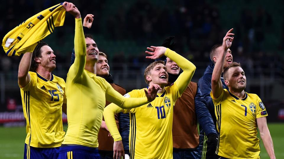 Sweden's players celebrate at the end of their FIFA World Cup 2018 qualification play-off. (AFP)