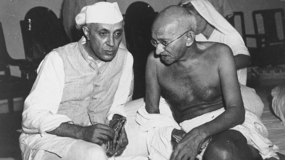 Mahatma Gandhi and Jawaharlal Nehru in conversation at the All-India Congress committee meeting at Bombay. Under the apprenticeship of Gandhi, Nehru emerged a strong leader and the architect of the modern Indian-nation state. (Central Press / Getty Images)