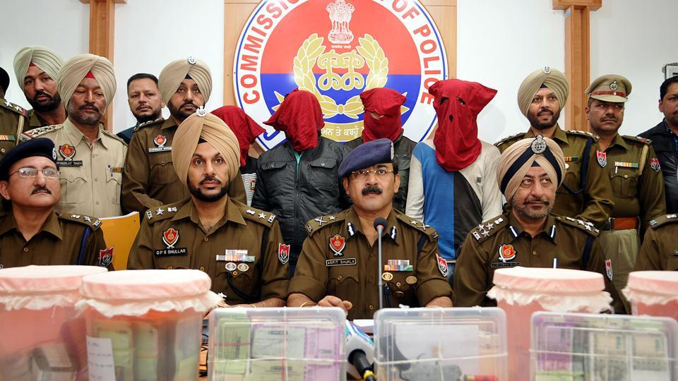 Police officials addressing a press conference in Jalandhar after arresting three accused, , including the mastermind, from Rajasthan.