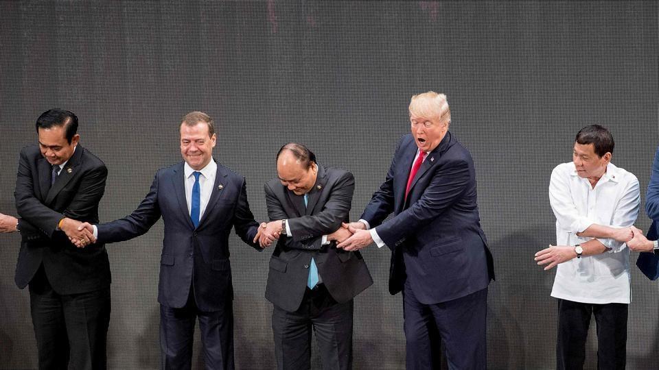 (L-R) Thailand's Prime Minister Prayut Chan-O-Cha, Russian Prime Minister Dmitry Medvedev, Vietnam's Prime Minister Nguyen Xuan Phuc, US President Donald Trump, and Philippine President Rodrigo Duterte join hands for the photo during the 31st Asean summit, Manila, November 13