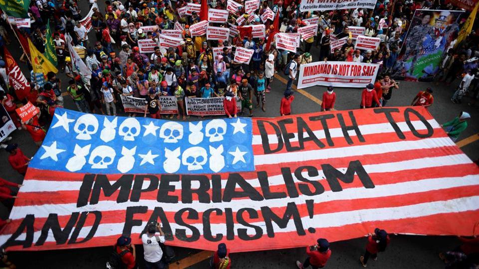 Protesters march towards the Malacanang Palace during a demonstration against US President Trump attending the ASEAN Summit in Manila. Rights groups had called on Trump to speak out over Duterte's drug war but the former has so far shown only warmth for a strongman leader who has boasted of personally killing people if the need arises. (Noel Celis / AFP)