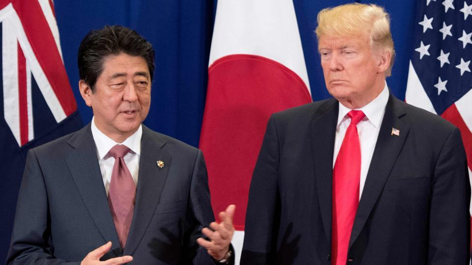 Japan's Prime Minister Shinzo Abe (L) talks to US President Donald Trump during the opening ceremony of the  Summit in Manila. (Jim Watson / AFP)