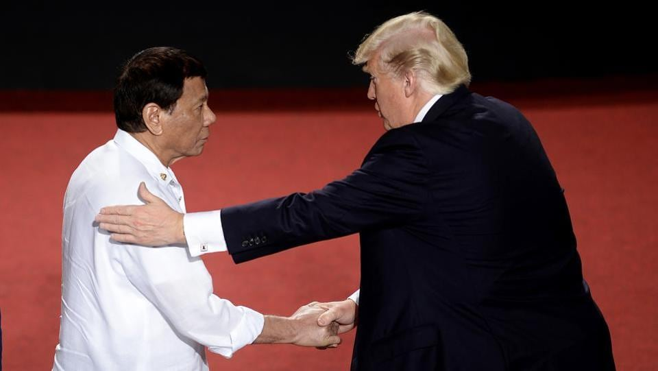 Philippine President Rodrigo Duterte (L), shakes hands with U.S. President Donald Trump during the ASEAN Summit on Monday. Their meeting was one of the most anticipated of the summit, with human rights groups pressing Trump to take a tough line on Duterte over his bloody war on drugs, in which thousands of people have been killed. (Noel Celis / AP)