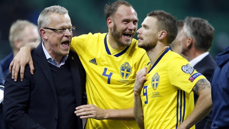Sweden coach Janne Andersson (L) celebrates with Andreas Granqvist and Marcus Berg. (AP)