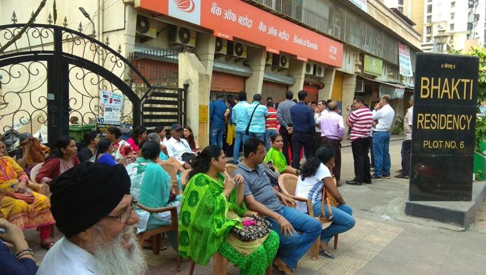 Worried customers wait outside Bank of Baroda's Sanpada branch, which was looted over the weekend.