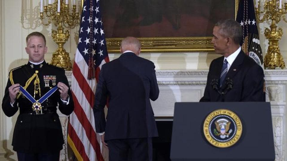 Former vice-president Joe Biden turns away as he wipes away tears after Barack Obama surprised him during a ceremony in the State Dining Room of the White House in Washington, to present him with the Presidential Medal of Freedom. (AP File Photo)