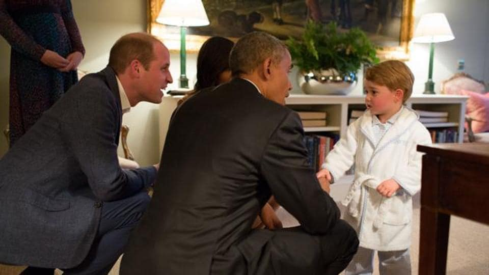 In this hand out photo released by Kensington Palace, Britain's Prince George meets with US President Barack Obama in London. (AP File Photo)