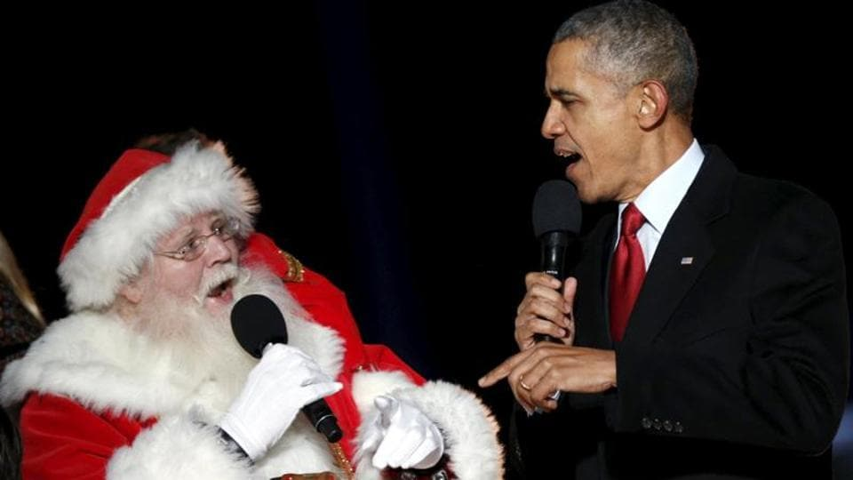 Barack Obama and a man dressed as Santa Claus sing onstage during the National Christmas Tree Lighting and Pageant of Peace ceremony on the Ellipse in Washington. (Reuters File Photo)