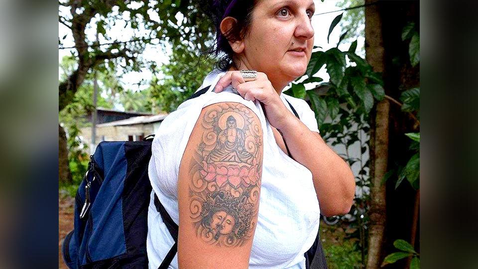 Buddha tattoo,UK woman with Buddha tattoo,crime in Sri Lanka