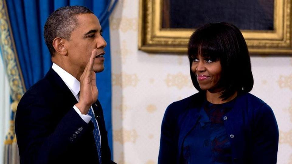 Barack Obama taking the oath of office at the official swearing-in ceremony in the White House in Washington. Holding the Bible is First Lady Michelle Obama (AFP File Photo)
