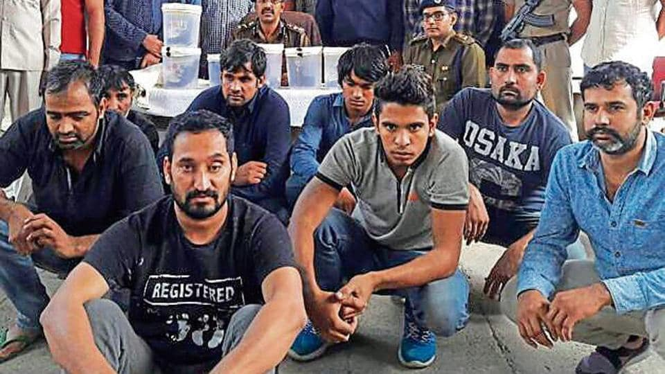 The accused in police custody on Tuesday. Police had announced a reward of Rs 7 lakh on one of the men arrested.