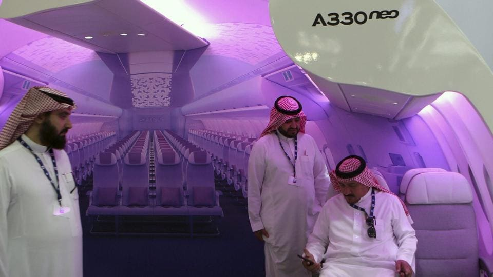 People check an A330 neo mockup at the Airbus stand during the Airshow in Dubai, United Arab Emirates.