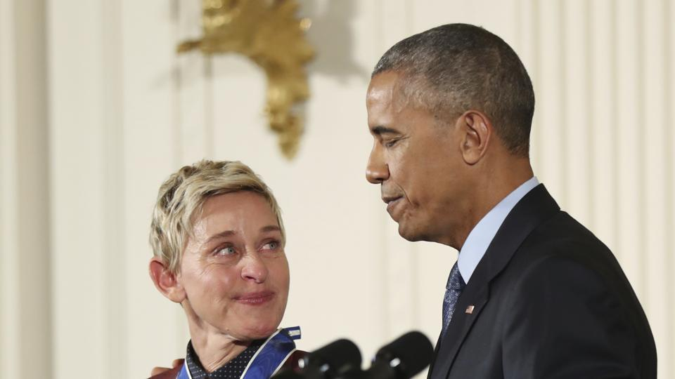 Comedian and talk show host Ellen DeGeneres glances at President Barack Obama as she is presented the Presidential Medal of Freedom during a ceremony in the East Room of the White House in Washington. DeGeneres made history 20 years ago as the first prime-time lead on network TV to come out, capturing the hearts of supporters LGBTQ rights. (AP File Photo)