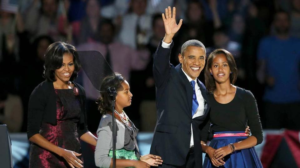 Barack Obama with former first lady Michelle Obama and their daughters Sasha and Malia on election night at Chicago, Illinois. (AFP File Photo)