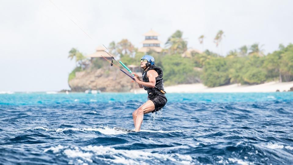 Former US president Barack Obama tries his hand at kite surfing during a holiday with British businessman Richard Branson on his island Moskito. (Virgin Handout via REUTERS)