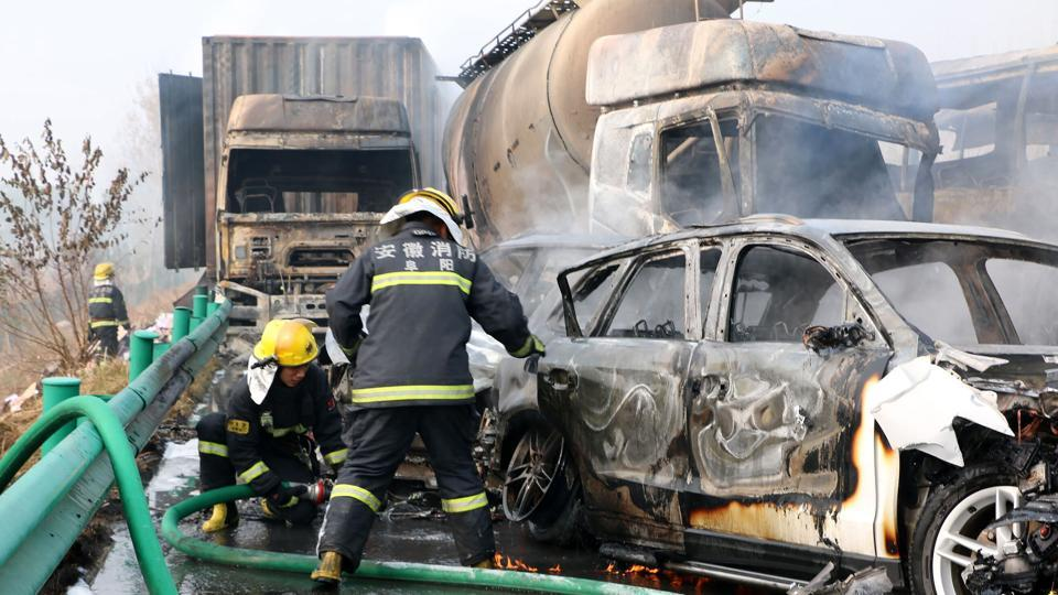 Firefighters put out fires after a highway accident in Fuyang in central China's Anhui province on Wednesday. Chinese state media 18 people were killed after more than 30 vehicles crashed into one another on an expressway in eastern China.