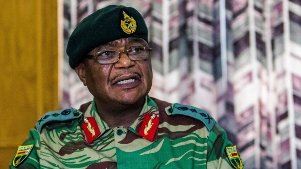 "General Constantino Chiwenga, Commander of the Zimbabwe Defence Forces addresses the media on November 13, 2017. Zimbabwe's ruling party ZANU-PF on Tuesday responded to Chiwenga challenging President Mugabe over the sacking of the vice president in a statement that said criticism was ""clearly calculated to disturb national peace... and suggests treasonable conduct on his part as this was meant to incite insurrection."" (Jekesai Njikizana / AFP)"