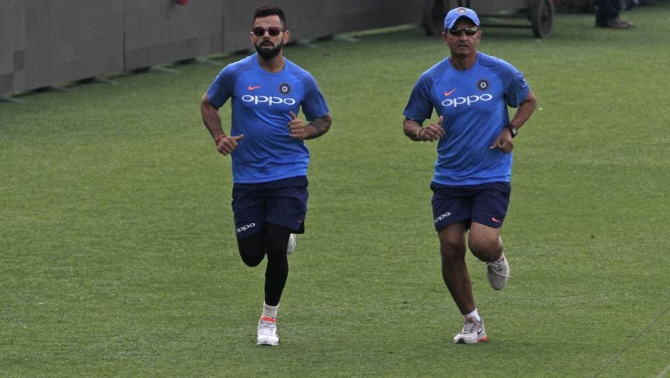 Kohli and batting coach Sanjay Bangar jog together at the Eden Gardens. (AP)